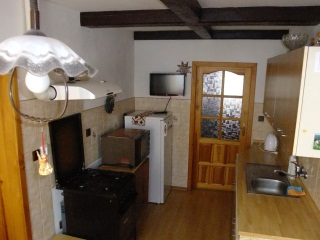 Kitchen with TV, fridge, microwave and cooker